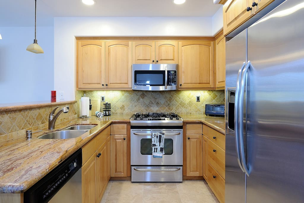 Great kitchen for cooking with upgraded stainless steel appliances and granite countertops.
