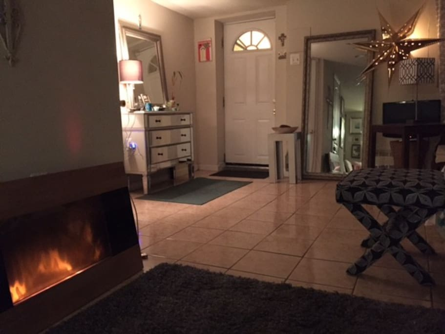 An electric fireplace (no heat) adds ambiance to a relaxing space.