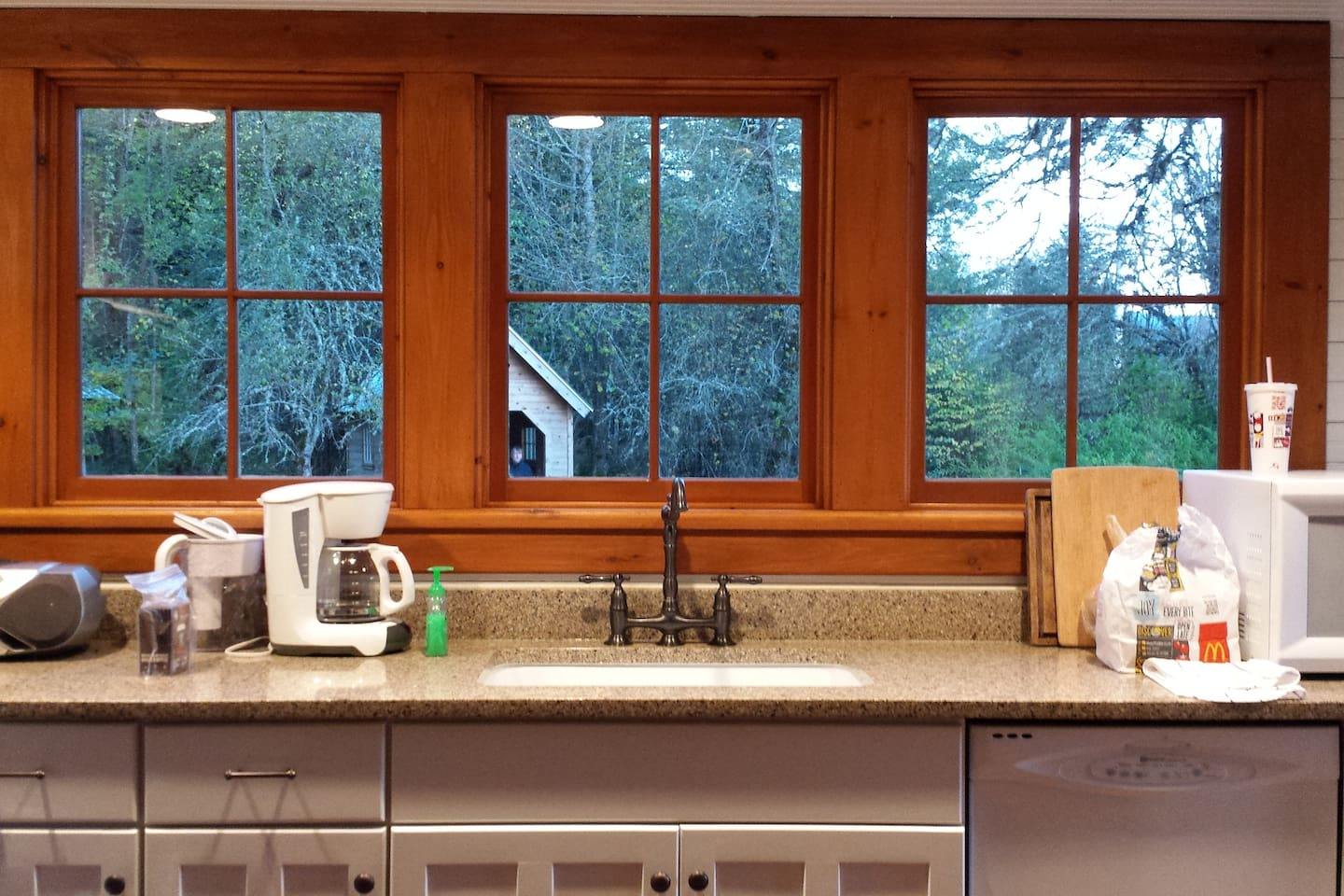 View looking toward a bank of windows in the kitchen