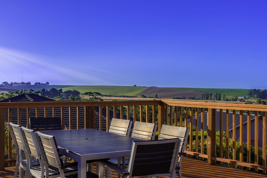 Bask in the afternoon and evening sun on the back deck and enjoy eats and drinks