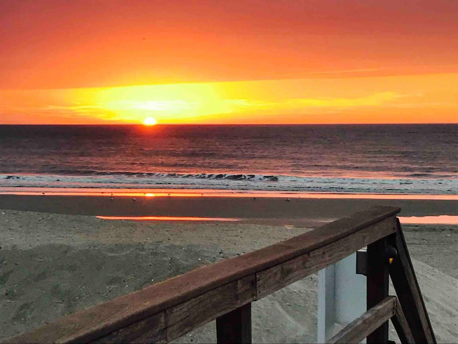 Wake up to the sunrise on the balcony or take a few steps to the beach!