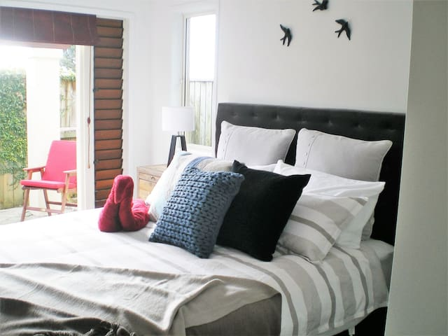 Main queensize bed with French doors to patio
