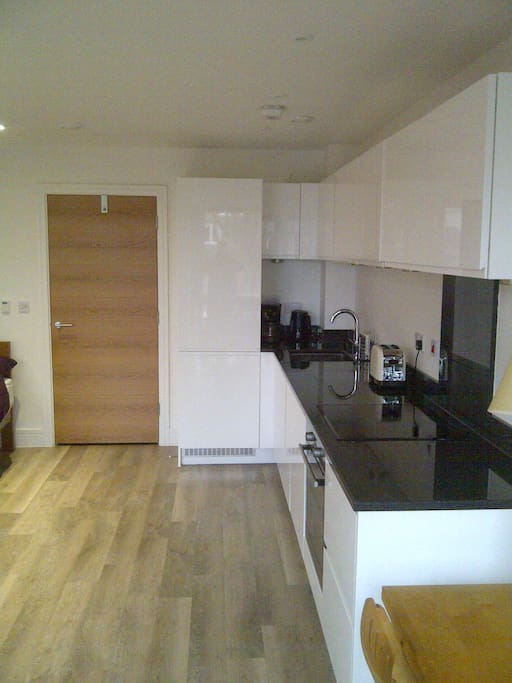 Good size, well equipped kitchen with granite work tops, washing machine and dishwasher