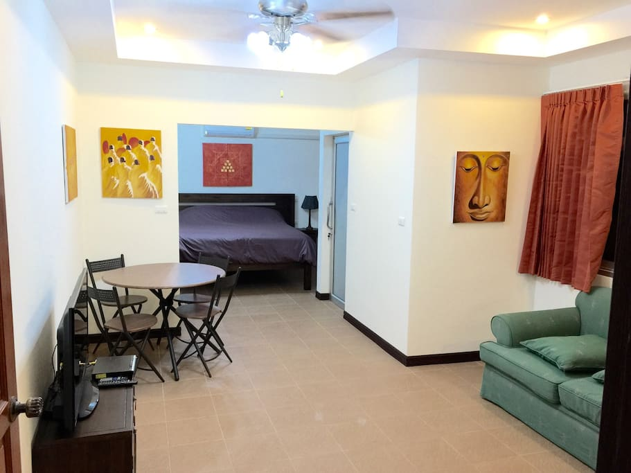 Family Apartment with king size bed and living room.