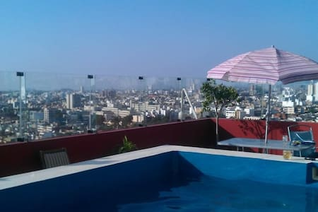 Room with rooftop pool access