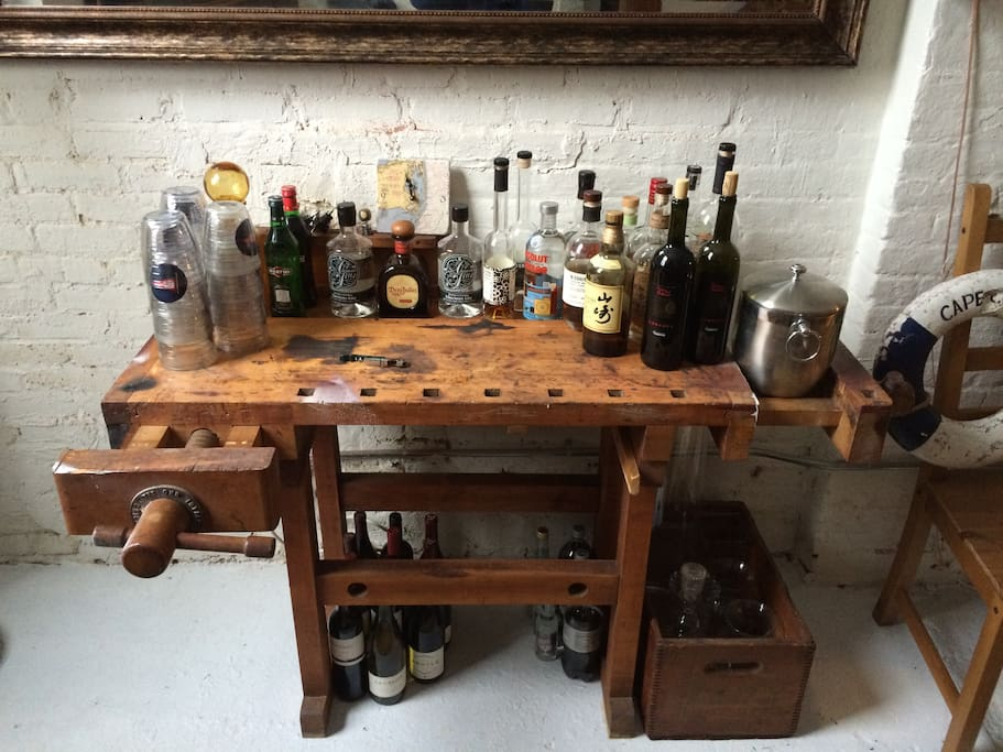 My 1950s work bench bar. All local spirits.