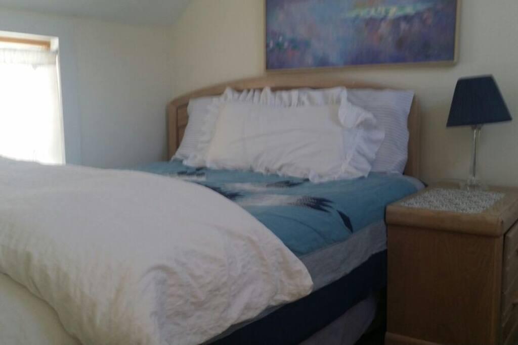 Queen bed in separate bedroom.