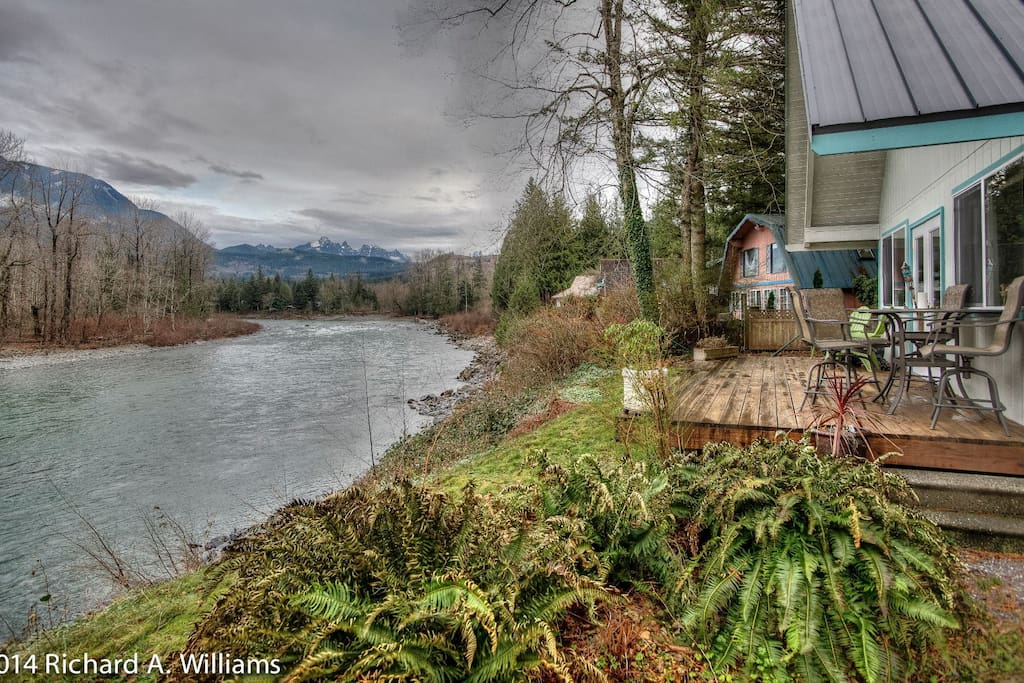 Winter shot of the river side of house