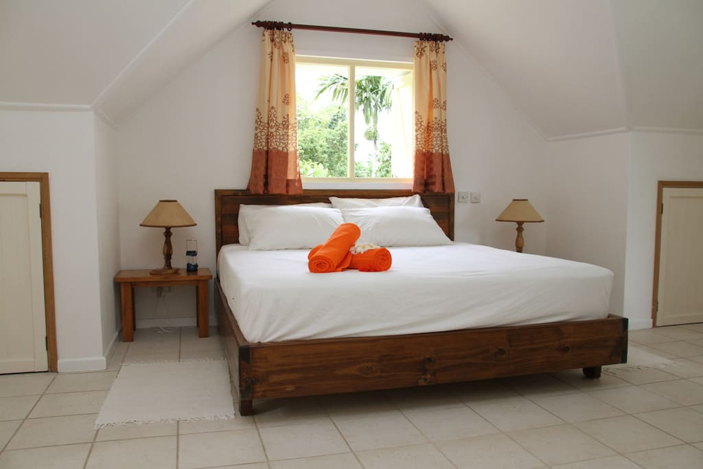 En suit double bed with safe, air condition and ceiling fan