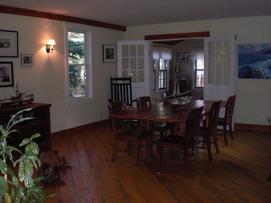 Dining for up to 8 people. Features a large reclaimed wood table.