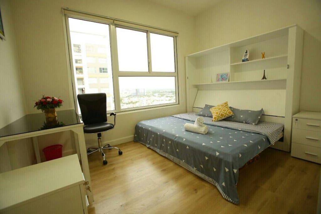 The cosy apartment where you can really feel like home - Bed room. You can view Saigon river lying on your bed :)))