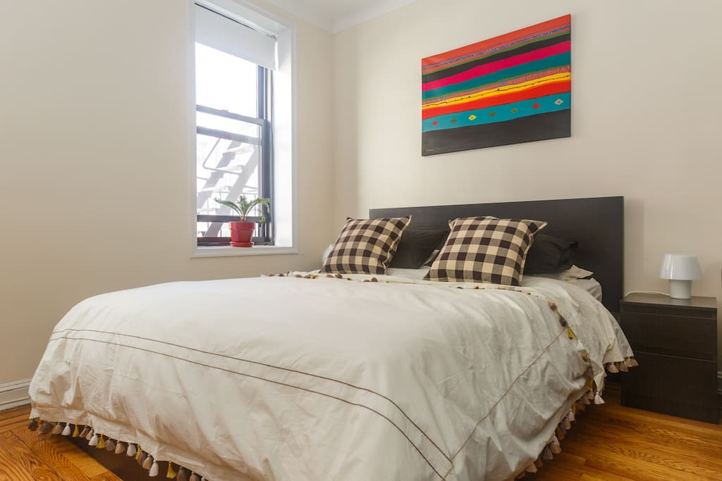 The bedroom: real queen size bed with fresh sheets.