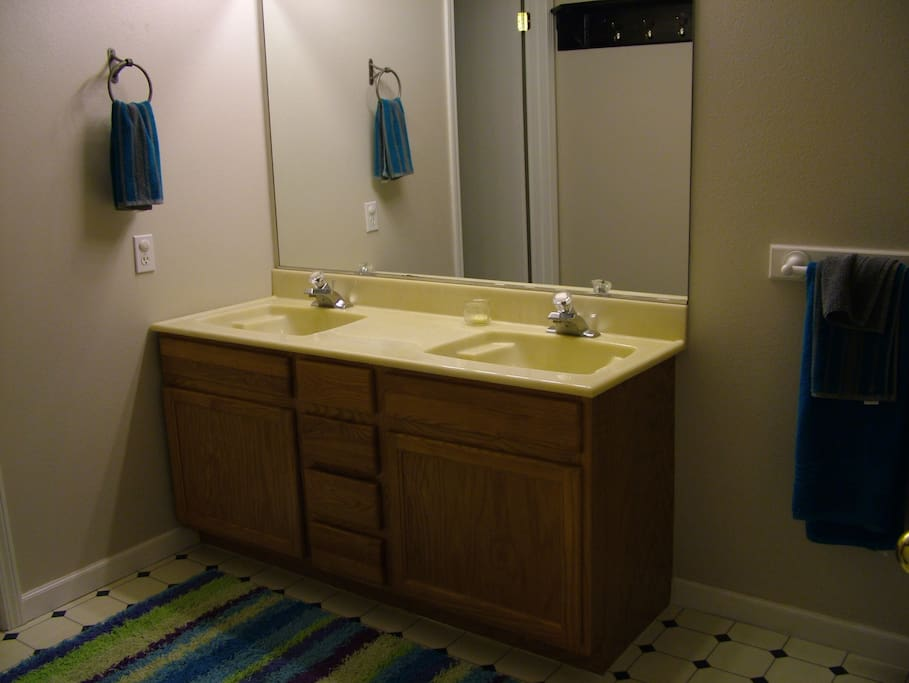 Large bathroom with separate toilet & tub rooms