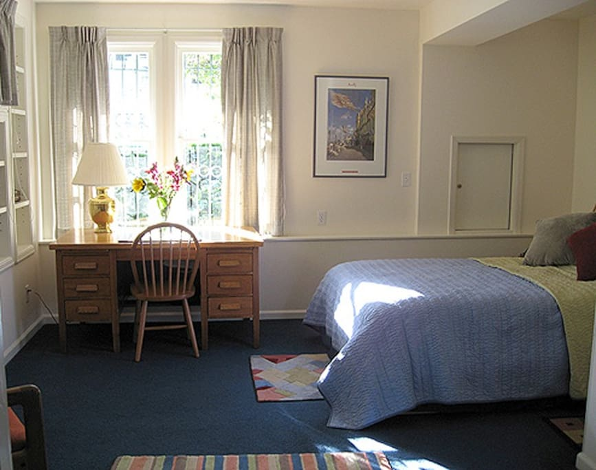 This spacious, sunny bedroom has a double bed, desk, chest of drawers and large walk-in closet.