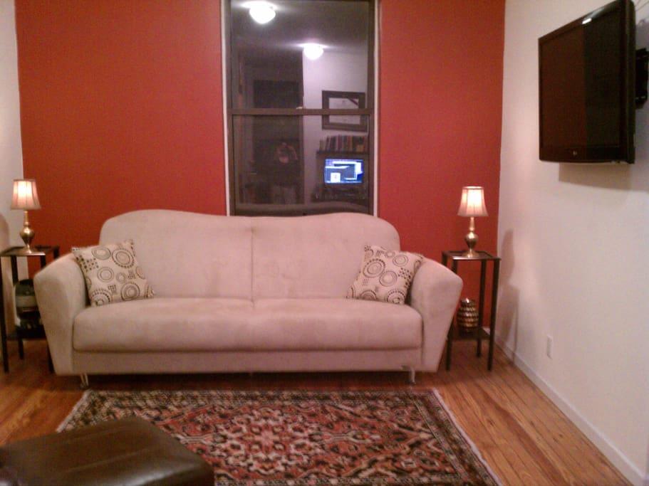 Living room with 42 inch flatscreen TV