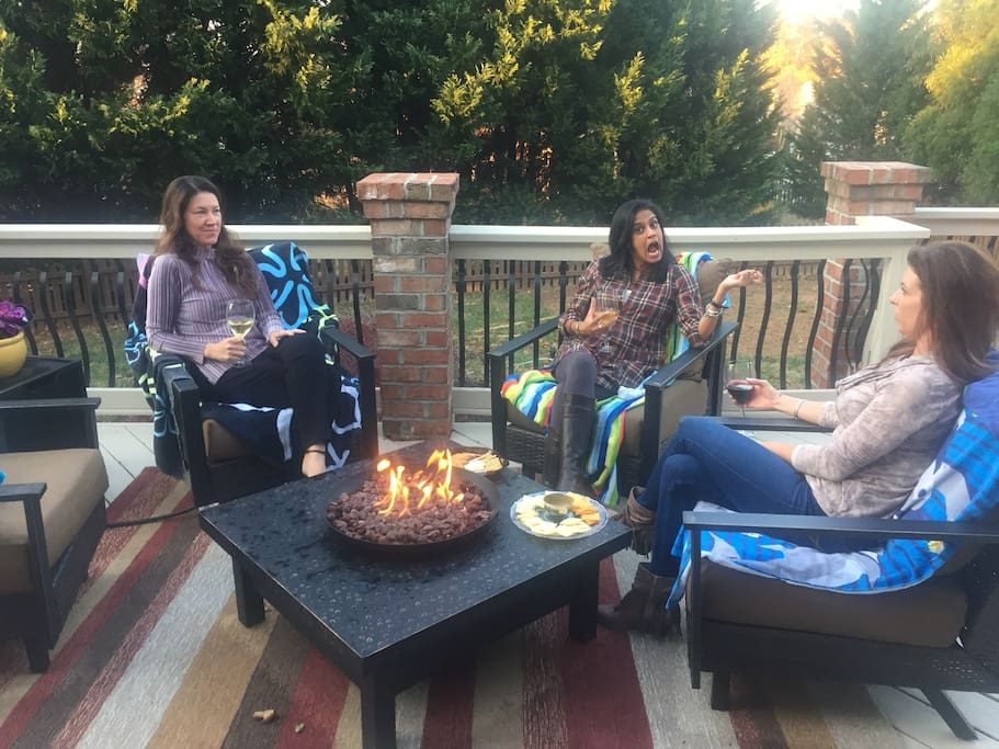Fire pit and conversation seating on oversized deck.  Models not included.