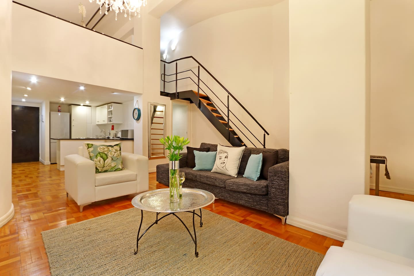 Summer Breeze: Living area with stairs to loft and kitchen in the background