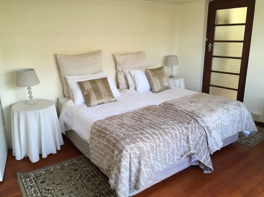 First Bedroom. 2 single beds, ample cupboard space, light and spacious. Beautiful wooden flooring
