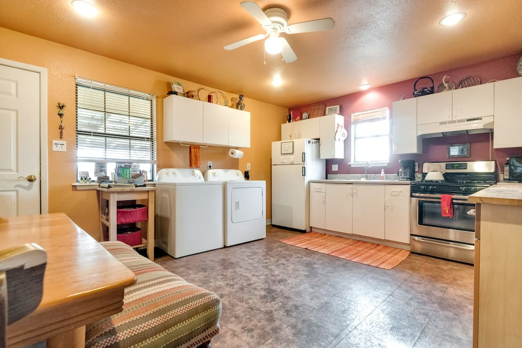 Roomy kitchen with a table and the washer-dryer