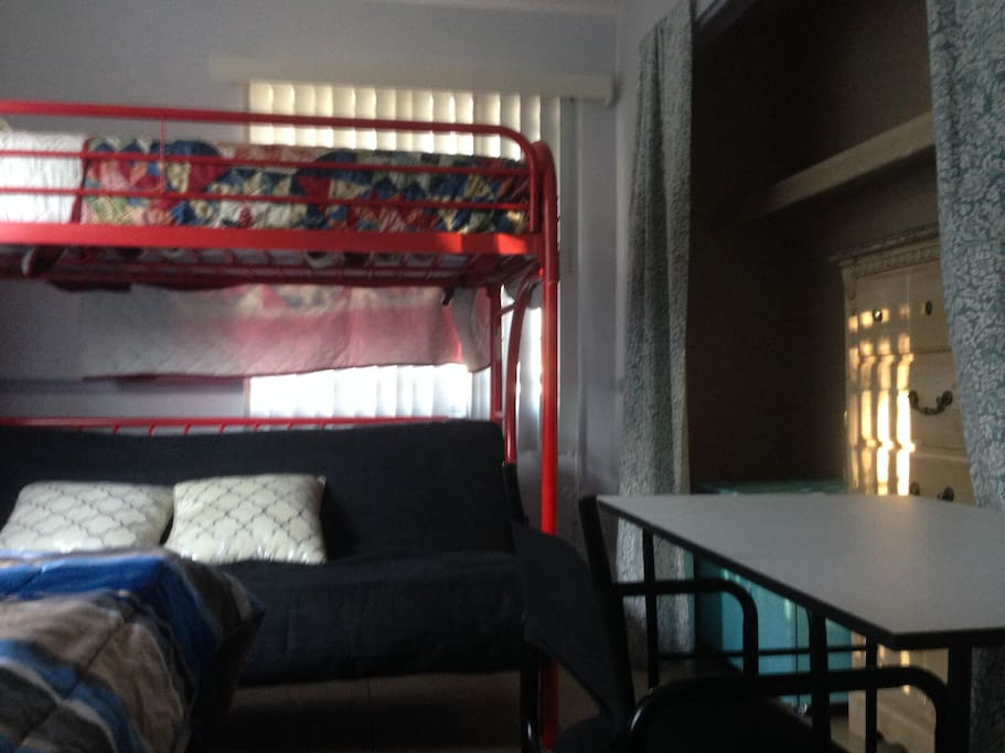 Shows top bunk on top of futon