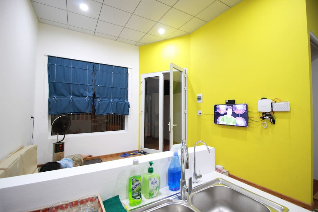The living room in yellow, next to our lovely kitchen corner. Free wifi connection in-house and cable TV.