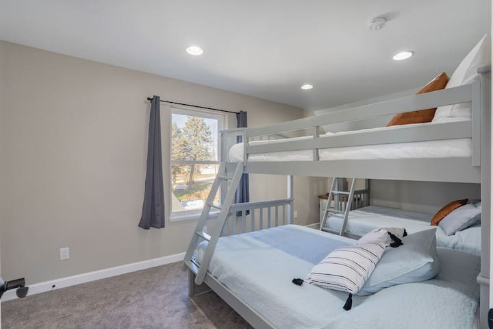 Upstairs bedroom with two twin over full bunkbeds.