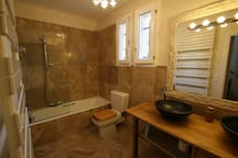 Bathroom 2 of 3 with double basins and shower over bath