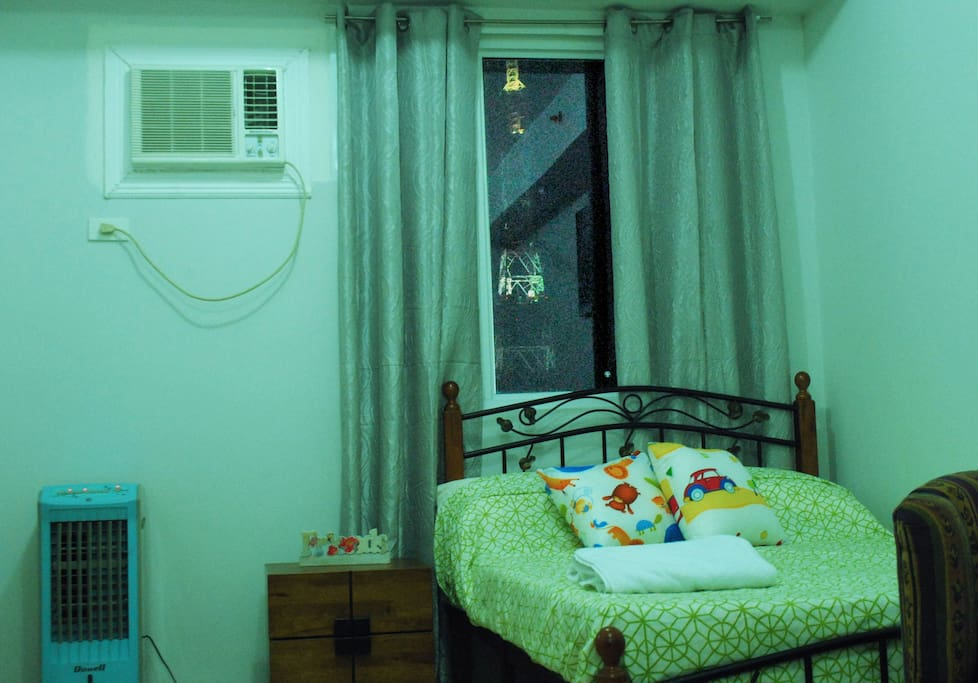 Bedroom and the mini Eiffel Tower view of Abs-Cbn