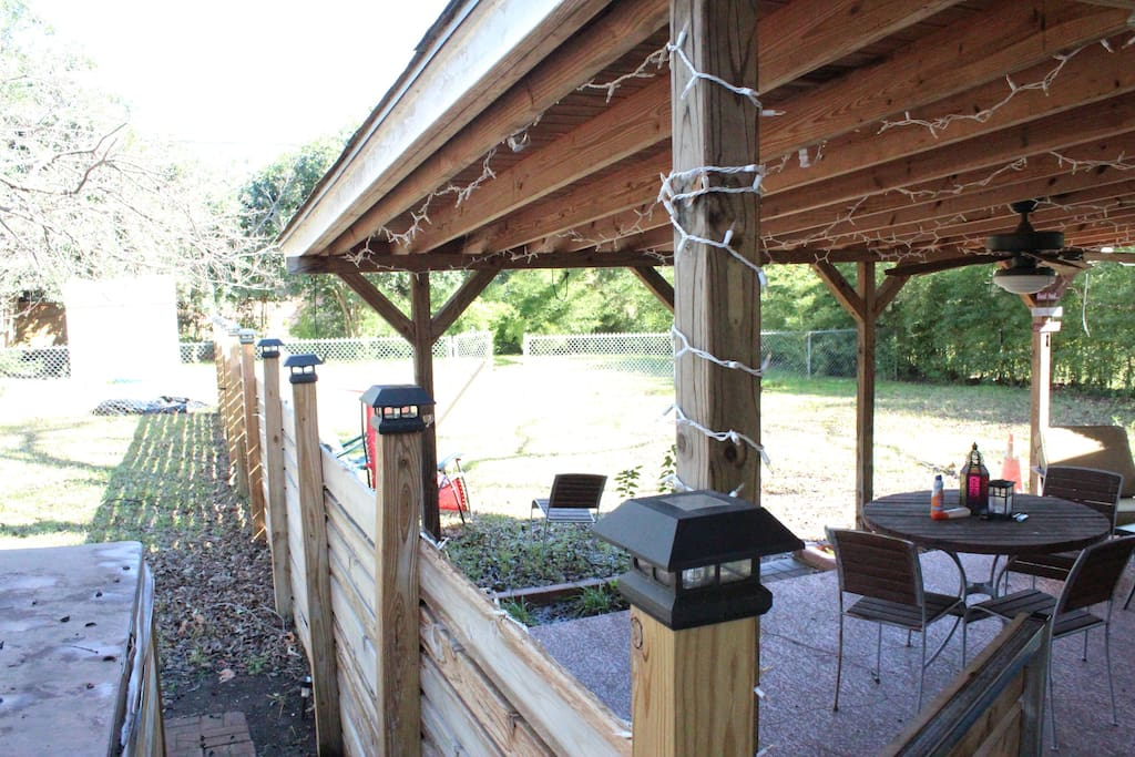 Outdoor living area, grill and hot tub in private fenced yard