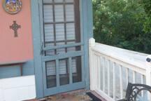 Balcony entrance to upper unit