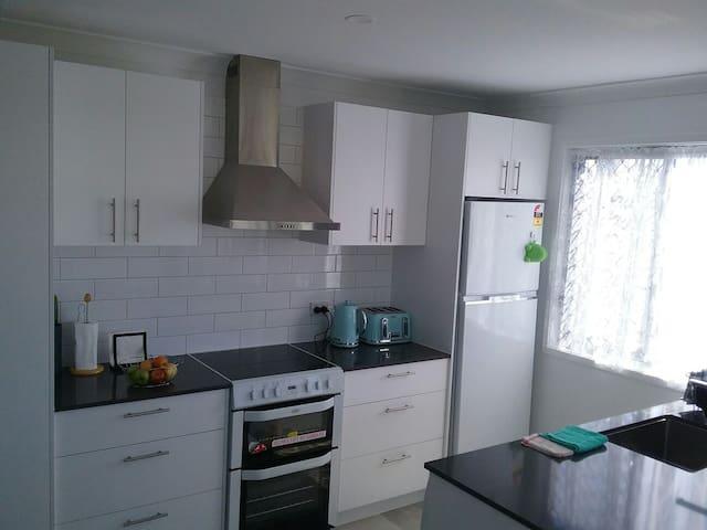 Kitchen - Oven,stove, fridge, toaster and tea & coffee