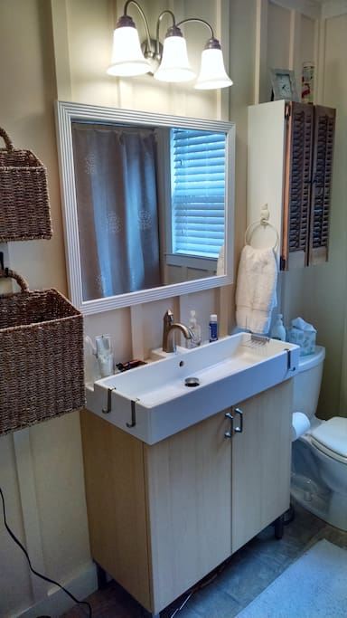 Remodeled, shared bathroom with nice tub/ shower.