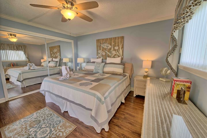Last but the best! Master bedroom includes a king size bed with new cooling gel hybrid mattress! This master is so romantic and relaxing for our guest. It has a huge walk in closest, cable TV and lay in the bed and watch the sunsets.