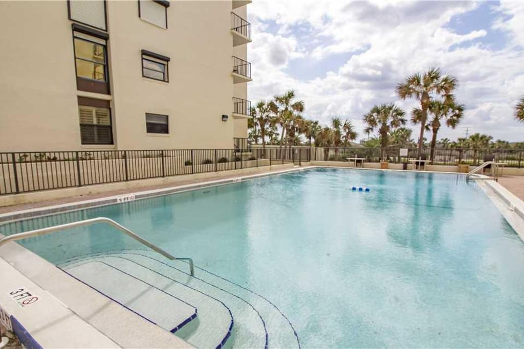 Our pool is ocean front! - Sparkling water and brilliant blue skies will make your vacation complete at Florida's vacation condo