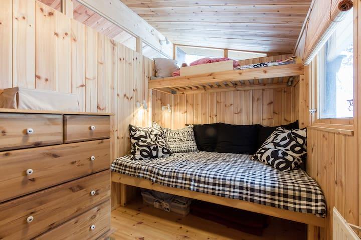C1. Second room, bunk beds, 140 cm ( the lower bed). Space for everyone on DVD nights. Please note no door between bedrooms.