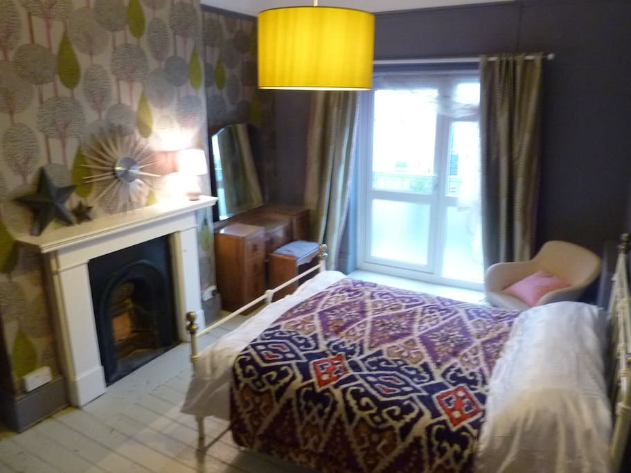 Generous double with private  terrace, period features and luxury mattress.