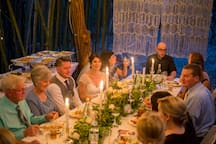Sweetgrass Weddings put together a beautiful tiny wedding and reception underneath the treehouse.  We allow intimate catered dinners for 15 people or less under the treehouse starting at $1500 for use of the space.   For larger parties, ask about pricing on the Bamboo Barn.