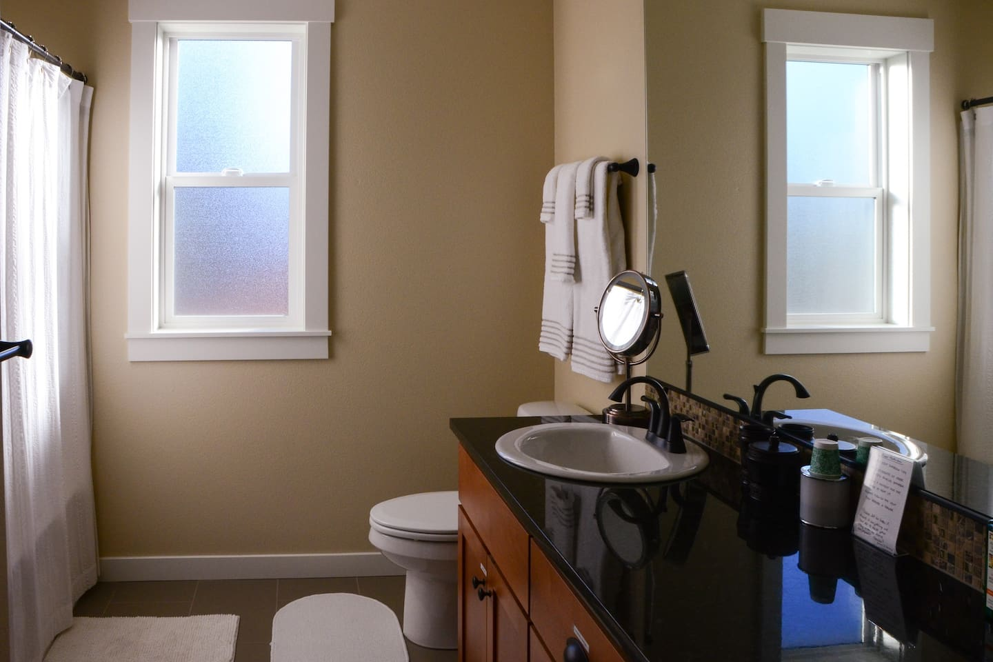 Full bathroom with shower, tub, and double sinks. Hospitality soaps, shampoos and toothpaste are available for your use. Guests typically have private use of bathroom, unless the second guest room is also booked.