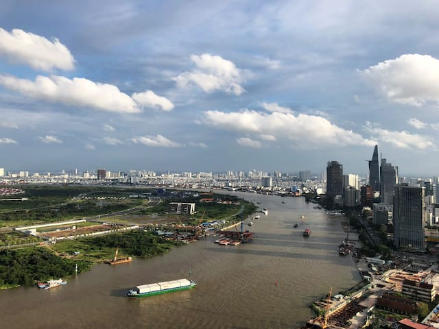 View of Saigon River and City during daytime taken at balcony.