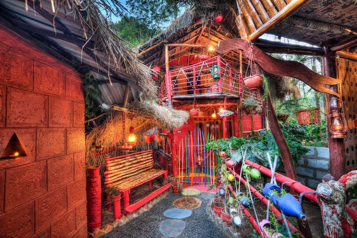 Rustic cottages with attic amidst the jungle !
