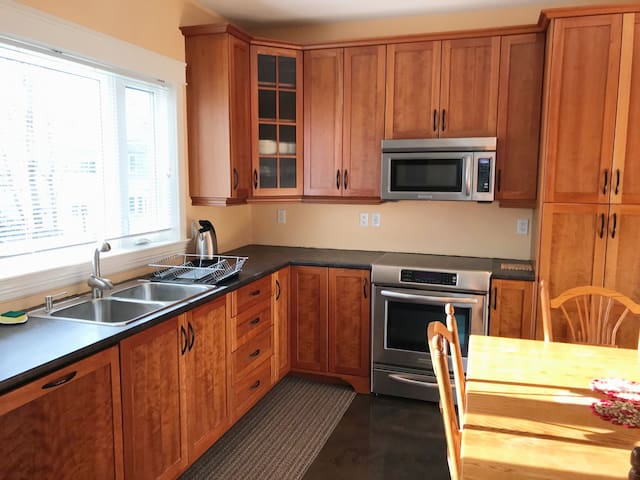 Central, bright 2 bedroom unit with parking