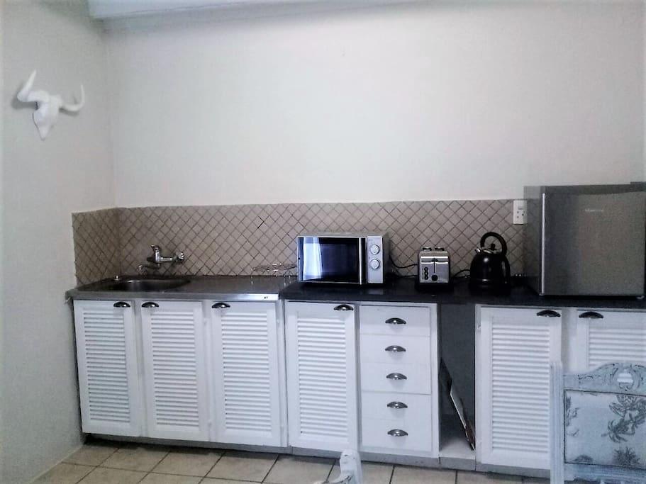 Duplex Cottage kitchenette with bar fridge, microwave,kettle & toaster.