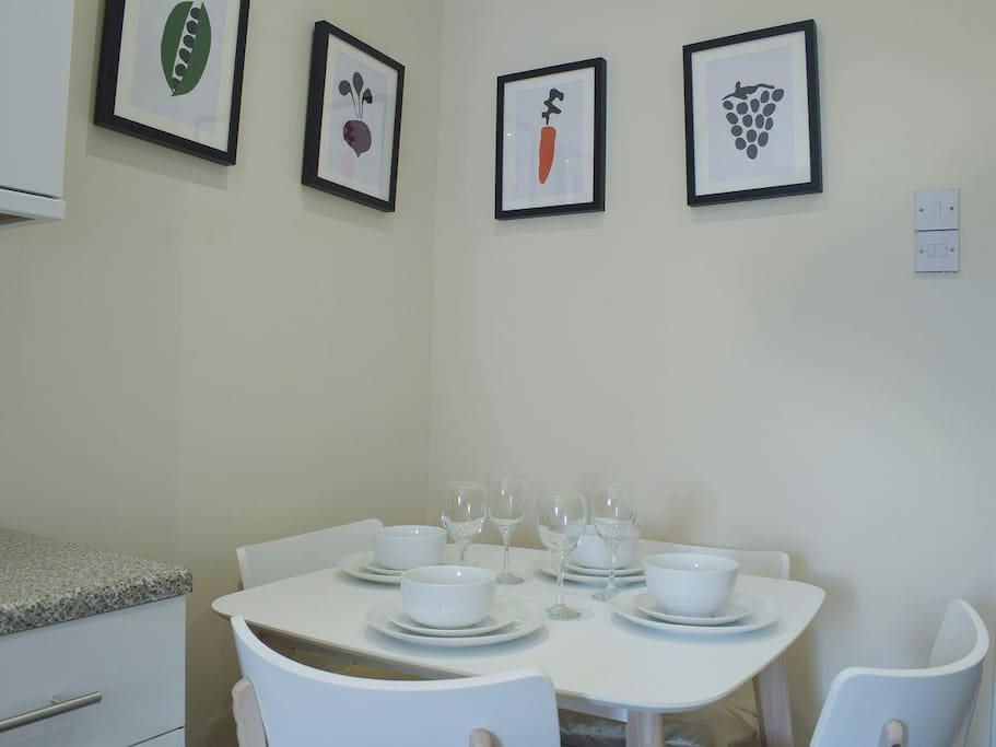 Dining area, ideal for seating either 4 of 2