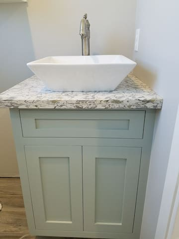 Granite counter tops with large pedestal sink.