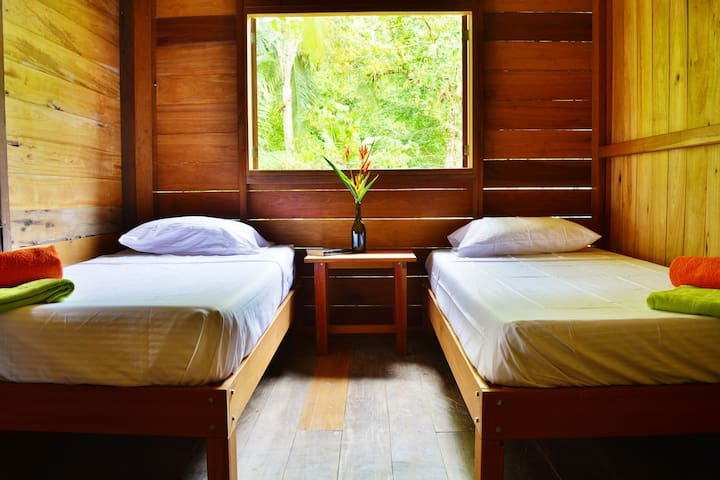 The second room with two single beds