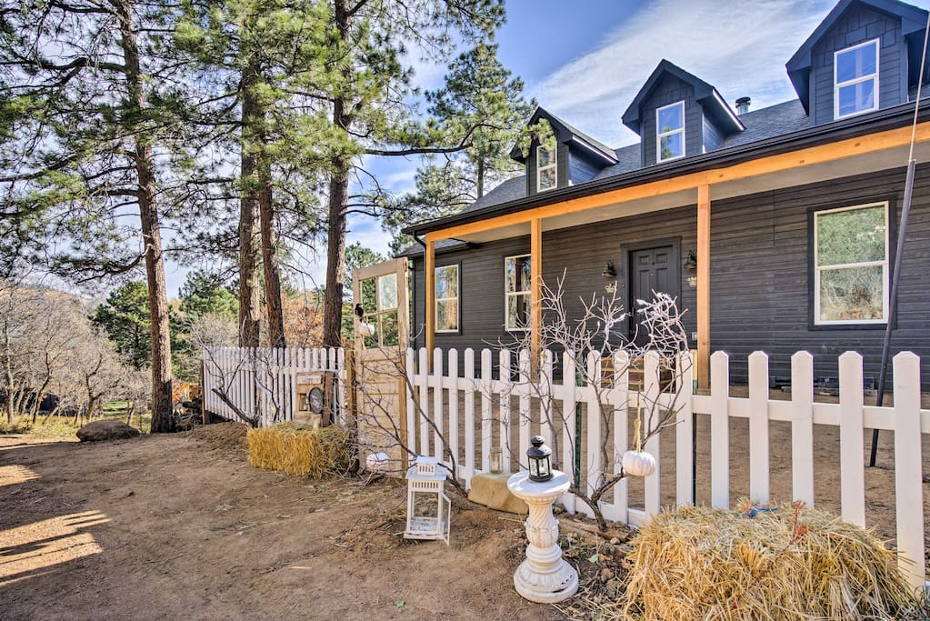Surrounded by a meadow full of trees, this charming home offers tranquility.