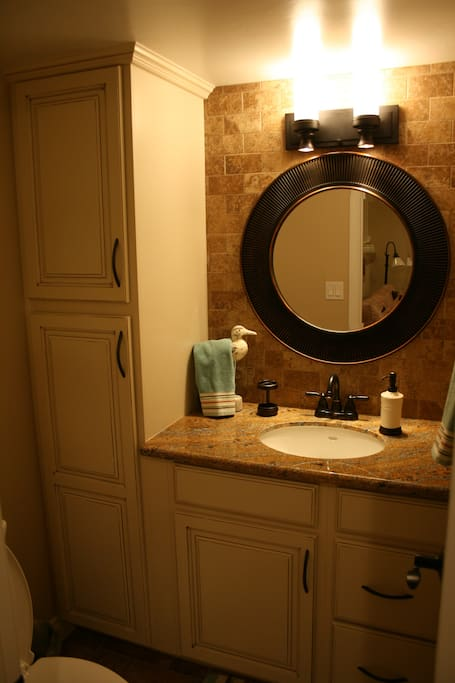 Freshen up in the downstairs powder room.