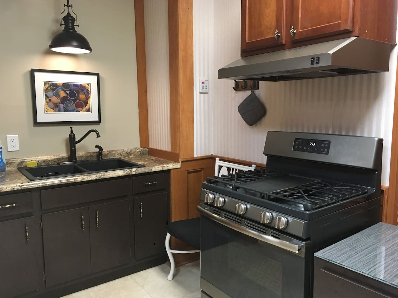 Kitchen has sink, gas stove, fridge, microwave, toaster and coffee pot.  Limited cooking wares and dishes.