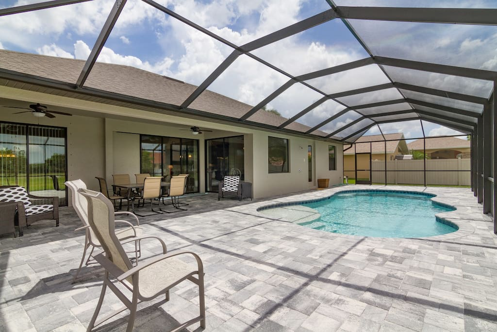 Large Lanai with patio furniture and gas grill
