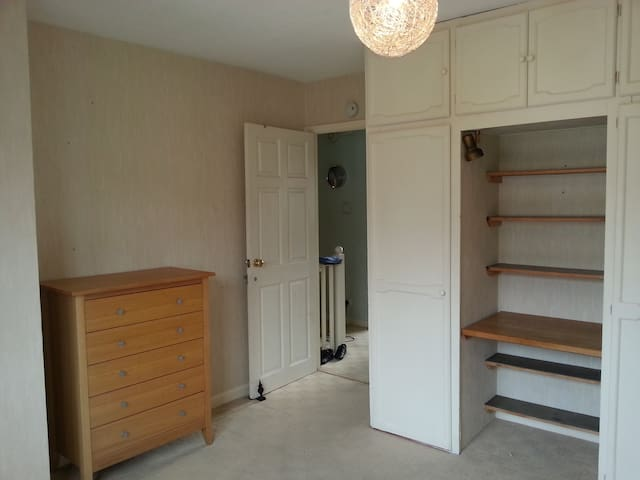 Wardrobe and chest of drawers for visitors use.